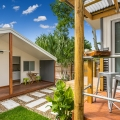 Kalani Tiny House, bathroom, kitchenette/laundry and courtyard.
