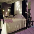 The Romance suite queen bed and twin