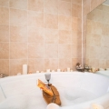 Ensuite bathrooom- two person jacuzzi bubble bath tub, shower nearby in suite
