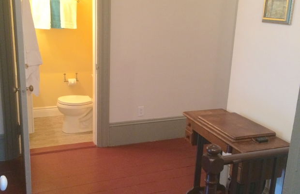 Two piece bathroom in hall, shared