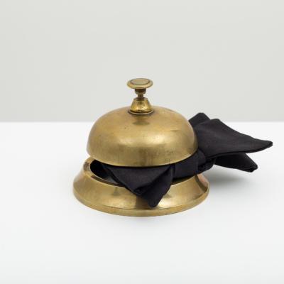 Une fois de plus -, 2015. Brass reception bell, silk bow tie, 10 x 13 x 7.5 cm.
