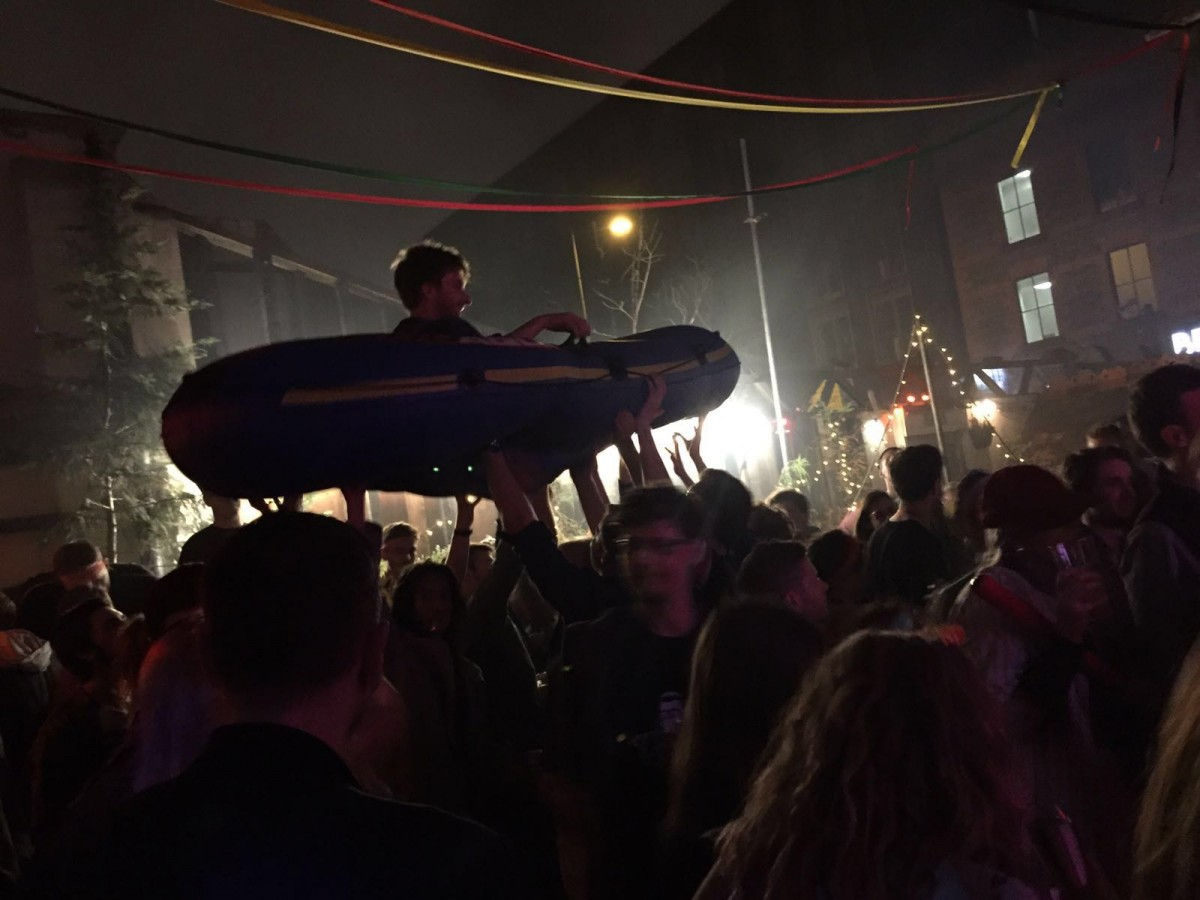 Rubber dinghy crowd surfing (photo by Emily Guest)
