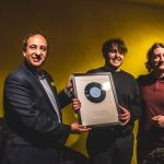 Astles receives his award