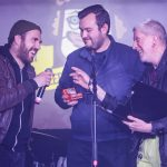 Liverpool Music Week's Mike Deane and Getintothis' Adam Lowerson collect Louis Berry's memento