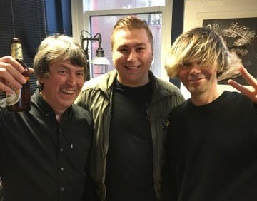 The Charlatans' Mark Collins (left) with Tim Burgess (right) and Getintothis' Lewis Ridley