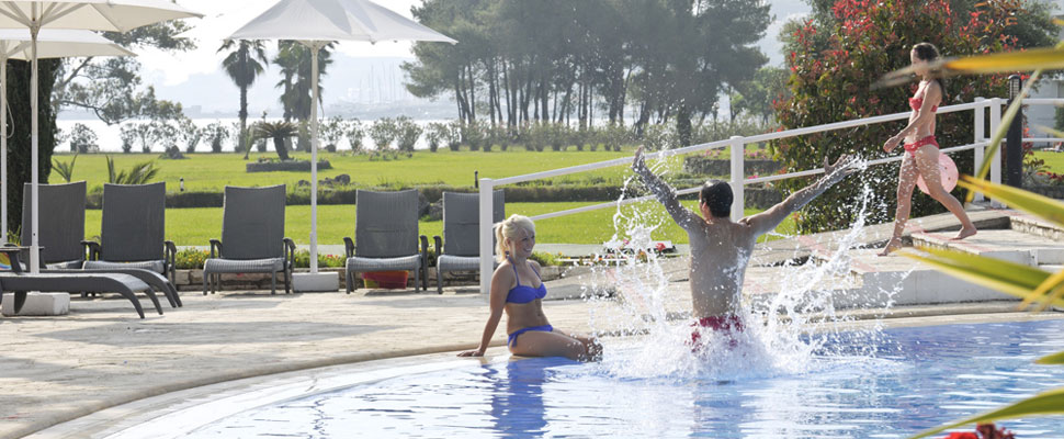 Louis Kerkyra Golf 4 star hotel in Corfu - couple in swimming pool