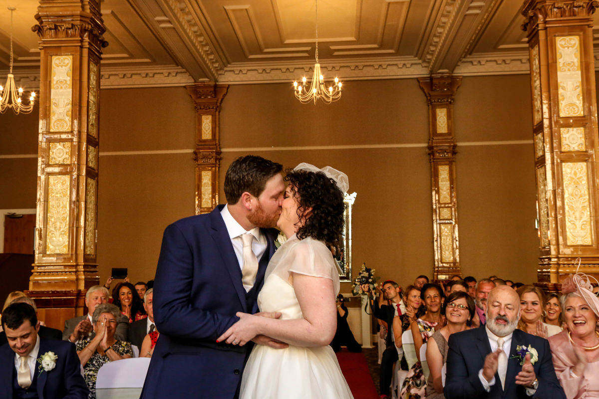 You May now Kiss The Bride, The Palace Hotel Manchester. Wedding Photographer Manchester and Cheshire.