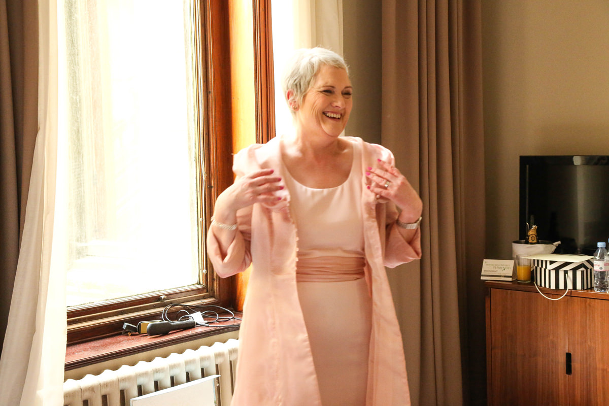 Candid shot in Pink, beautiful light at The Palace Hotel, Manchester Wedding Photographer
