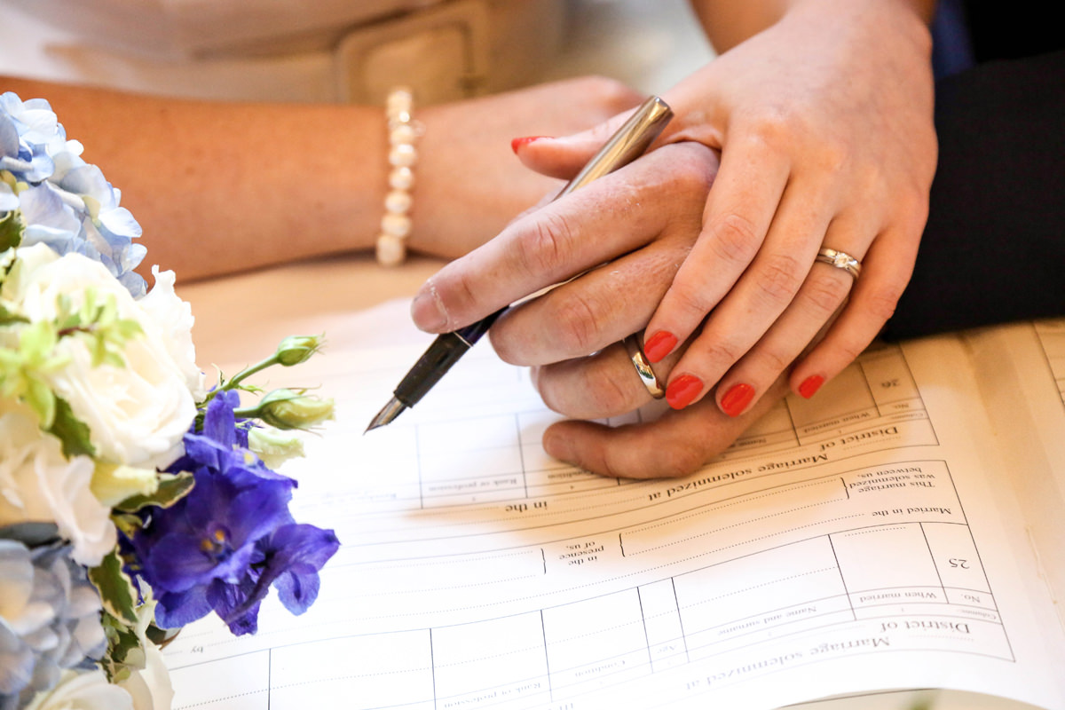 Signing the Register at The Palace Hotel Manchester. Wedding Photographer Manchester and Cheshire.