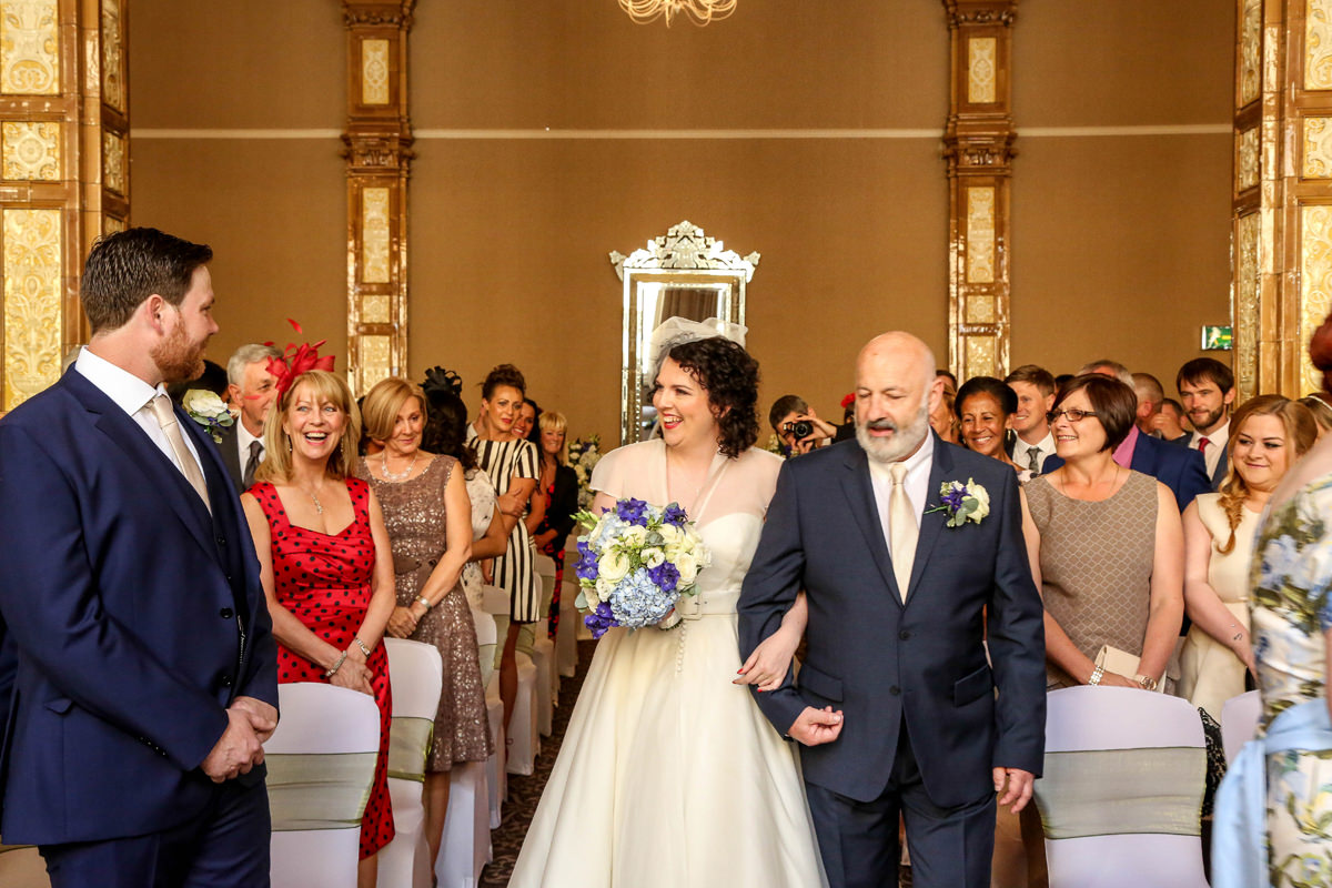 Father Walks the Bride down the Aisle at The Palace Hotel Manchester. Wedding Photographer Manchester and Cheshire.
