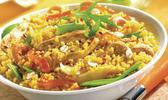 Wok de poulet aux noix de cajou, légumes primeurs et couscous parfumé aux epices du monde