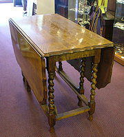 Golden oak gateleg table from