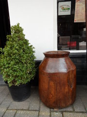 large primitive wooden vessel