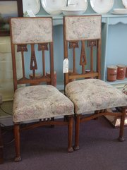 pair of arts and crafts influenced chairs