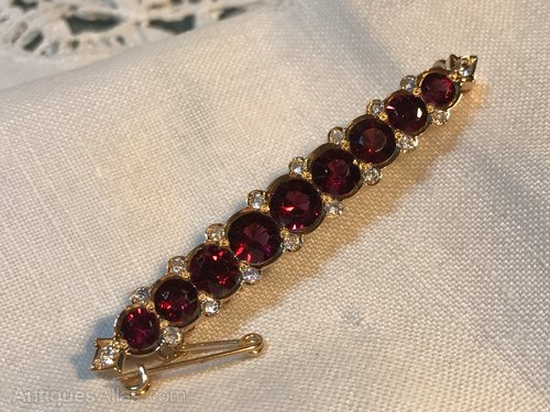 Vintage garnet and cubic zircona bar brooch