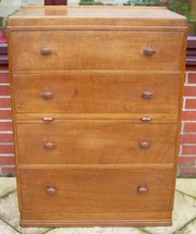 A Heals solid oak chest of dra