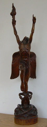 A figural wood carving by Faus