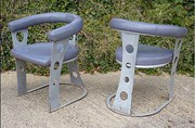 Pair of upholstered steel armc