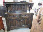 A mid 20th century moulded oak
