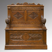 Carved oak boxseat settle