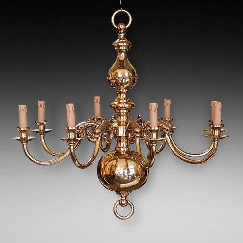 A large brass eight branch chandelier