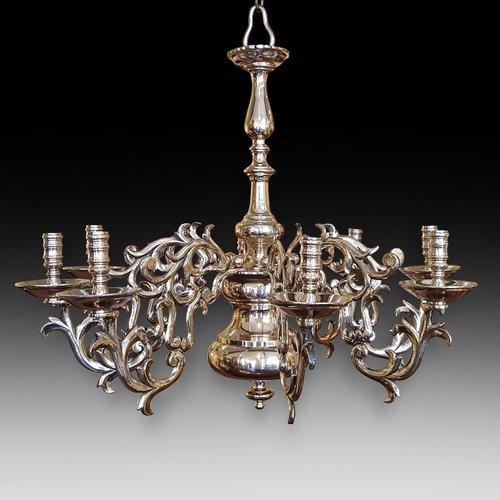 Eight branch brass chandelier