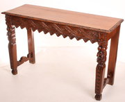 Carved oak hall consul table