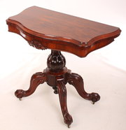 Rosewood serpentine card table