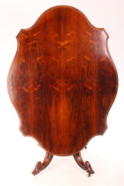 Shaped rosewood loo  dining ta