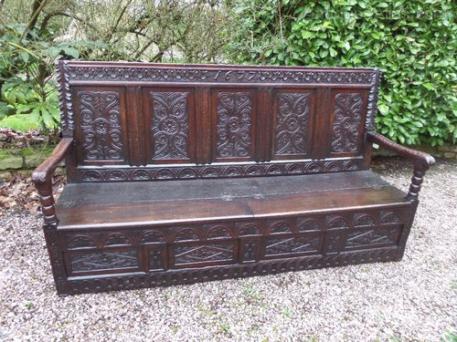 Large 18thc Carved oak box seat settle dated 1677