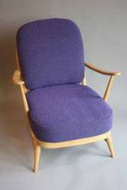 Low backed armchair by Ercolan
