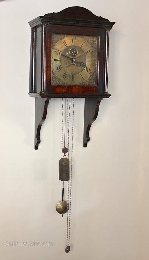 Georgian Walnut Hooded Wall Clock. U160