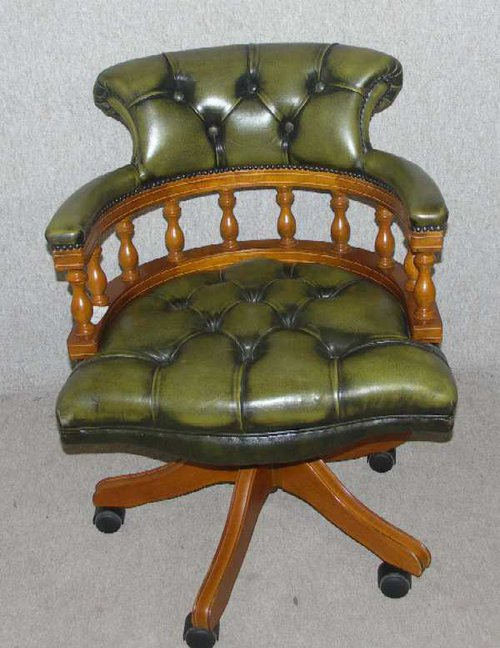 green leather captains revolving office chair with button back and