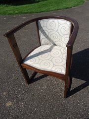 Art Nouveau tub chair with piercings to sides