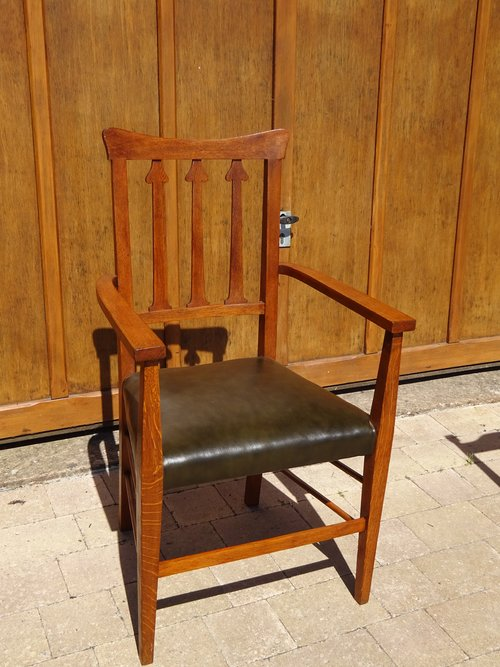 Arts & Crafts Armchair with leather seat.
