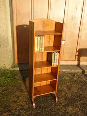 Arts & Crafts Bookcase with yin-yang piercings