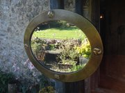 Arts & Crafts Liberty brass mirror with yin-yang