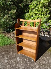 Arts & Crafts Oak bookcase with central heart.