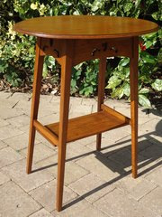 Arts & Crafts Oval oak table with  pierced apron