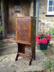Arts & Crafts Pokerwork oak cabinet