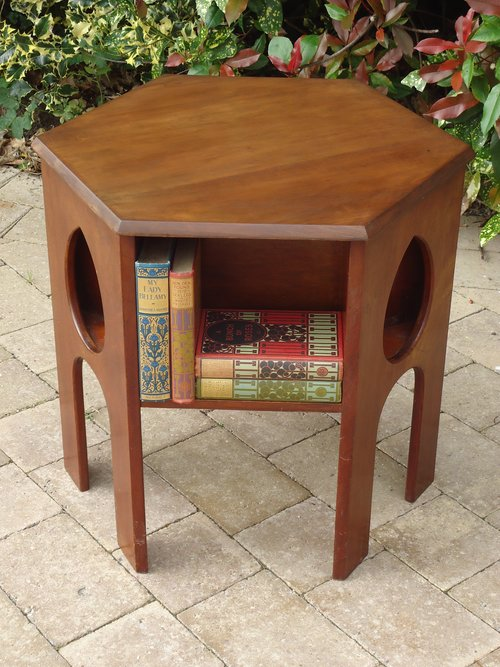 Arts & Crafts book table with cut out teardrops