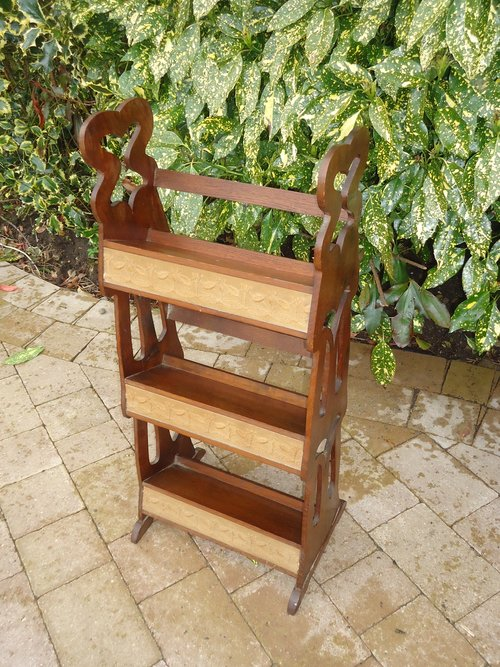Arts & Crafts bookcase with embroidery panels