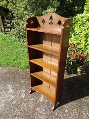 Arts & Crafts bookcase with pierced spades