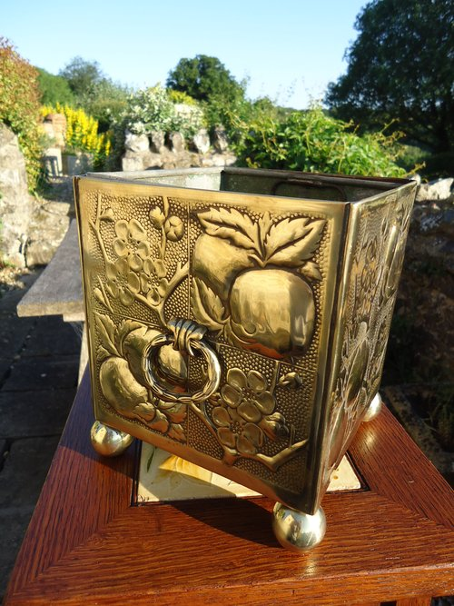 Arts & Crafts brass planter with lead liner