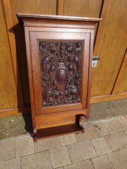Arts & Crafts carved Gothic wall cupboard