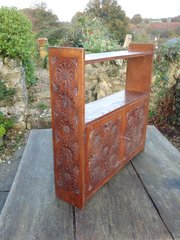Arts & Crafts carved oak hanging cabinet