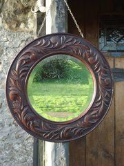 Arts & Crafts carved oak mirror. Keswick