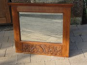 Arts & Crafts carved oak mirror with squirrel