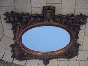 Arts & Crafts carved oak mirror with tulips