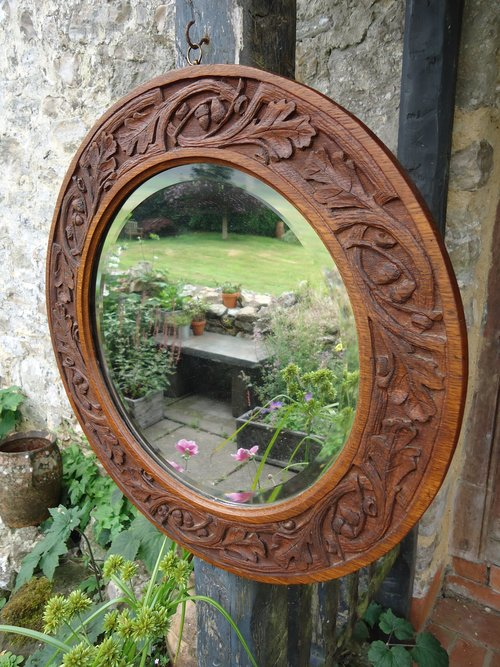 Arts & Crafts carved oak mirror with acorns